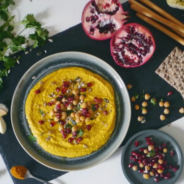 Turmeric hummus is a satisfying snack with added health benefits.