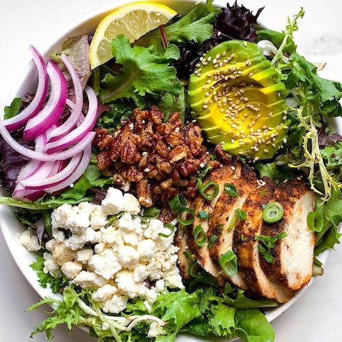 Miso paste and balsamic blend well together and add depth and variety to the classic balsamic vinaigrette in this chicken and pecan salad.